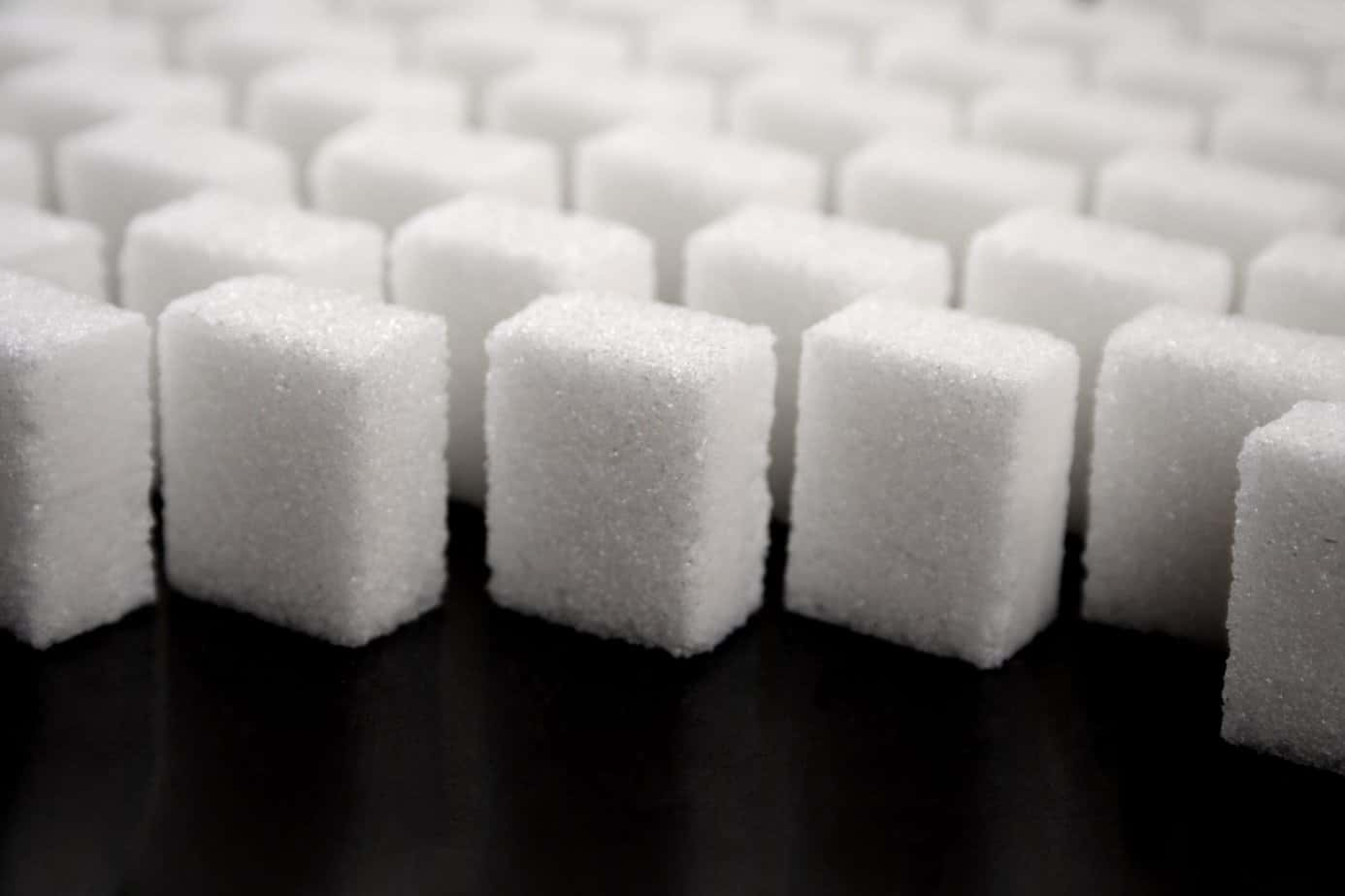 Sugar cubes showing why you should think about reduce your sugar intake in 3 easy steps