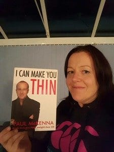 Picture of hypnotherapist holding copy of Paul Mckenna's book 'I can make you thin'