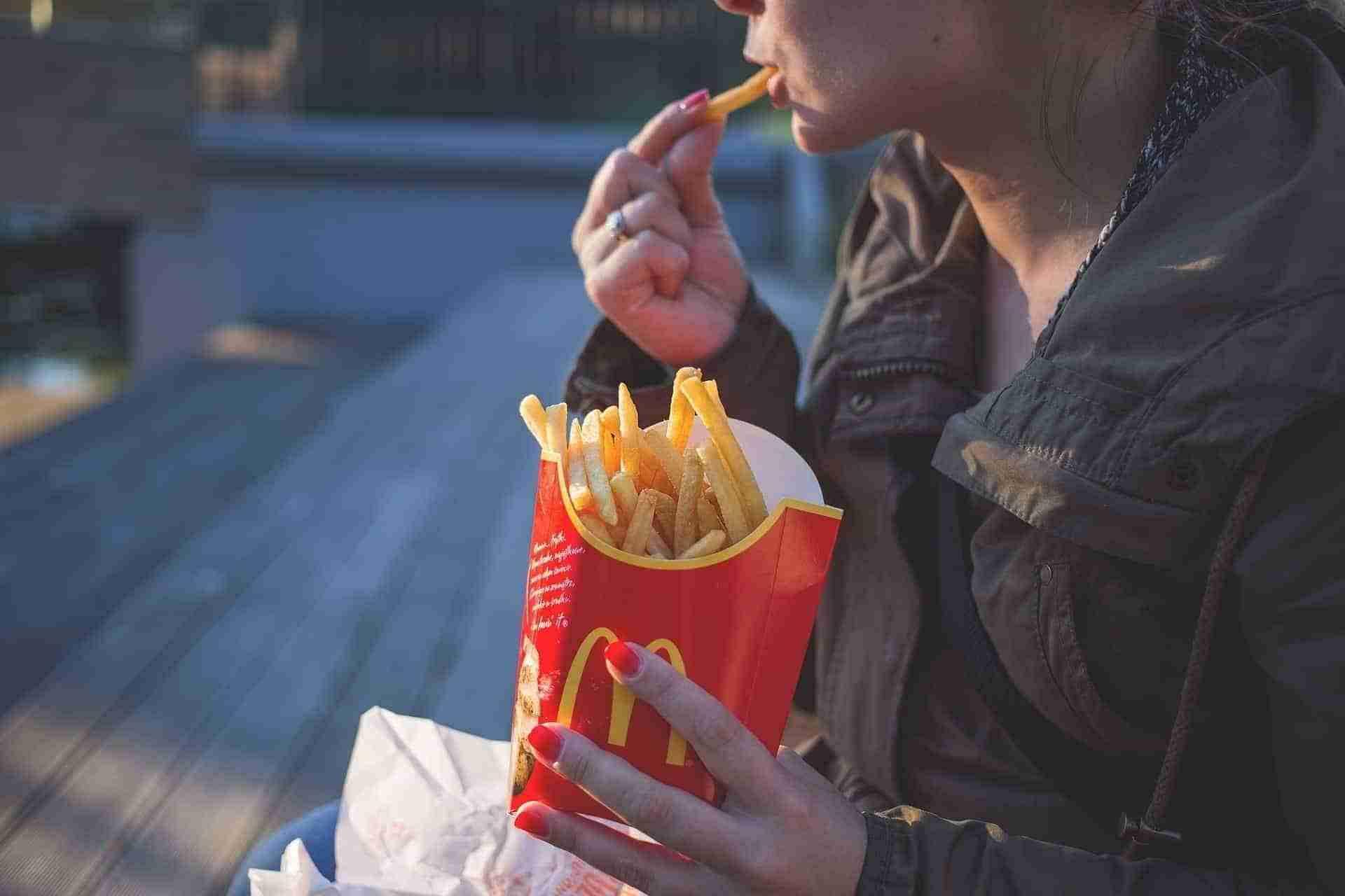 woman eating Macdonalds chips