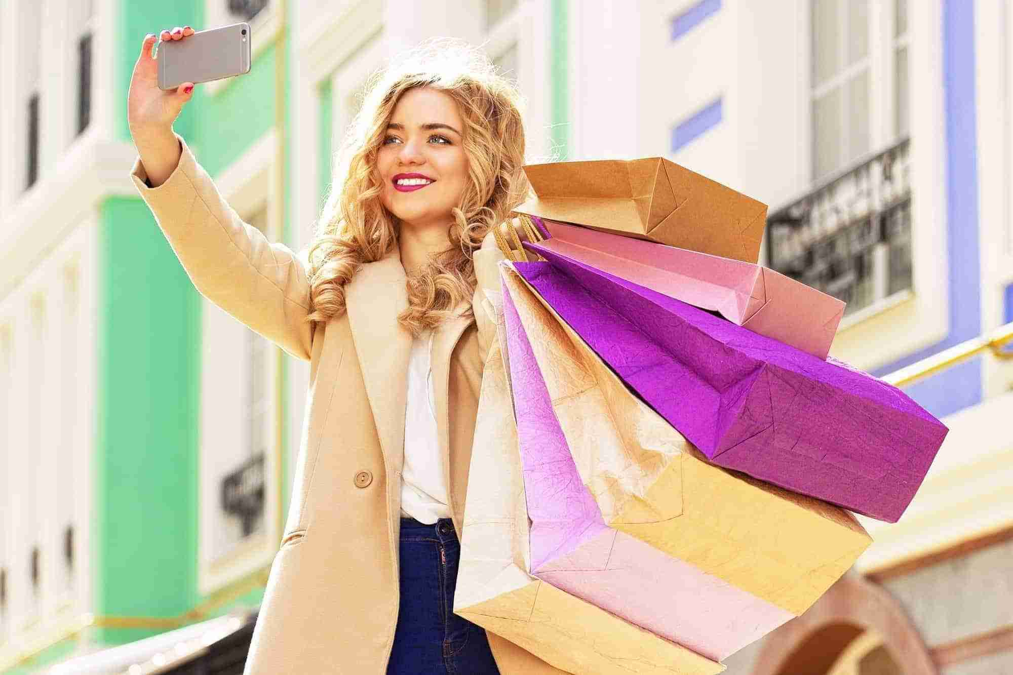 Woman taking selfie after shopping on Black Friday