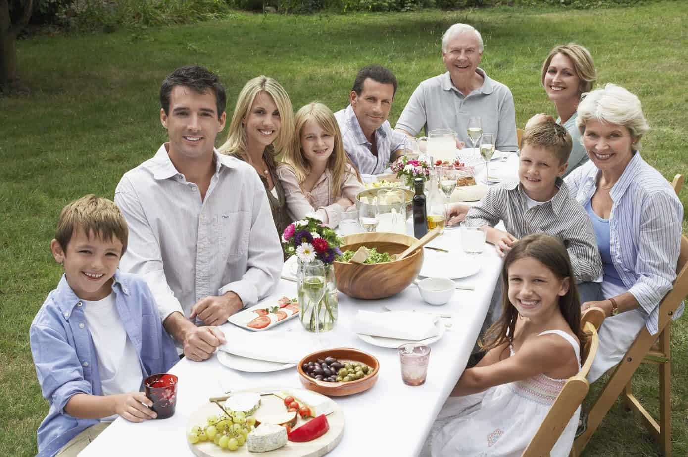 Group of people around a dinner table who might at some point consider hypnotherapy or counselling
