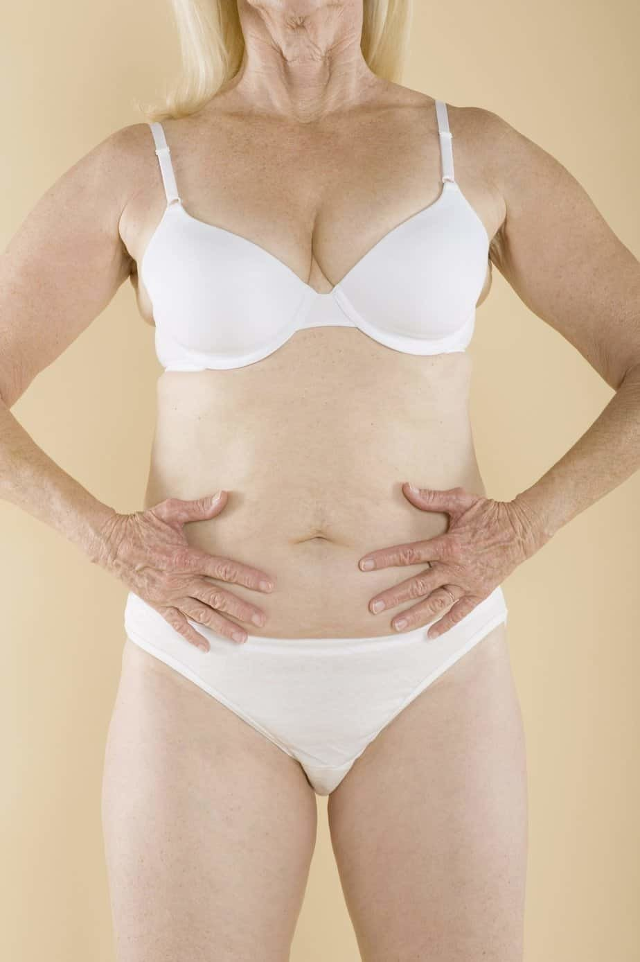 Woman showing her stomach for Healthy eating for good mental health