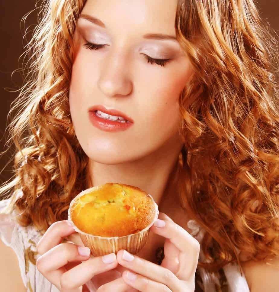 Woman eating a cake during emotional eating
