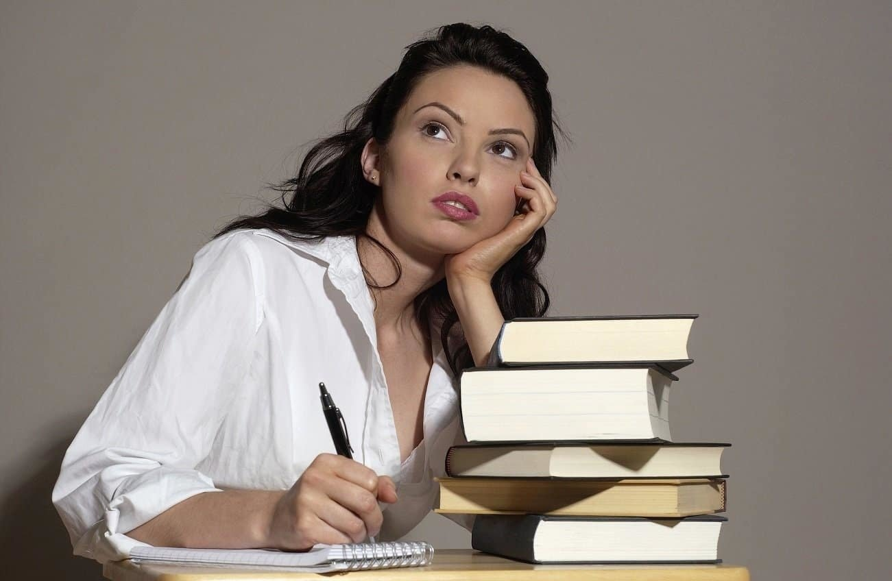 Woman with books staring into distance