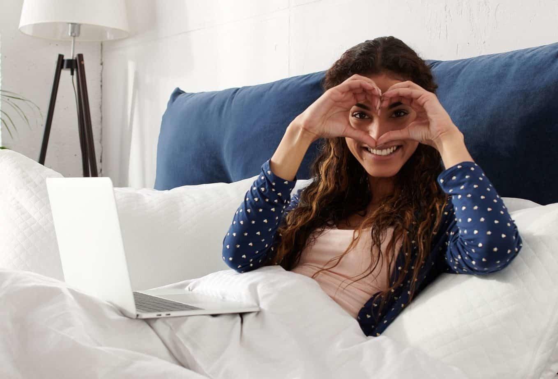 Women lying in bed attending self-hypnosis workshop